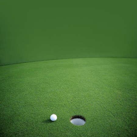 putting green: Golf ball falls just short of its goal