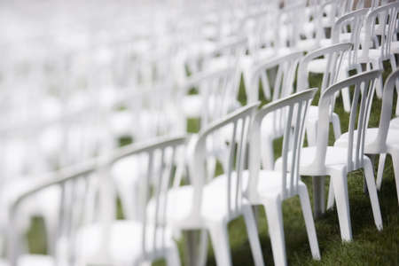 White plastic chairs set for an outdoor event Stock Photo
