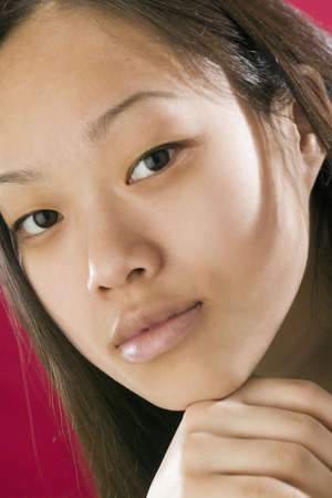 Close view of young Asian girl looking serious  photo
