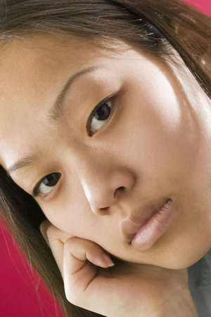 Close up view of a young Asian girl with an intense stare photo