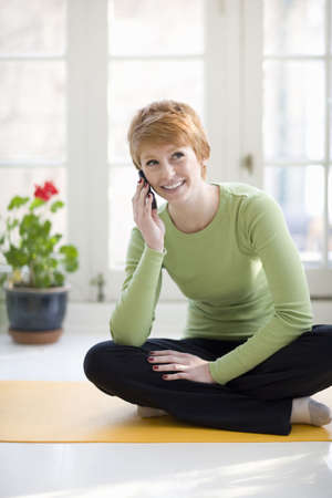 Happy young woman talking on a cell phone Stock Photo