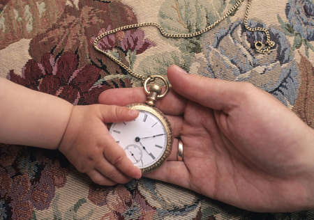 the inheritance: Father giving child antique pocket watch Stock Photo