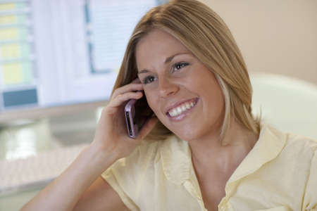 Close-up of smiling young woman using the phone. Horizontal format. Stock Photo - 5841004