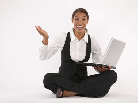 Young woman sitting on floor using laptop. Horizontally format. photo