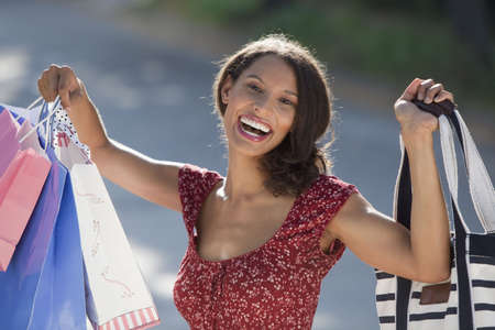 Young woman with shopping bags. Horizontally framed shot. Stock Photo - 6043481