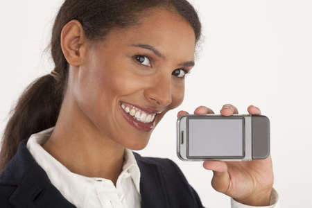 Closeup of young businesswoman holding mobile device. Horizontally framed shot. Banco de Imagens