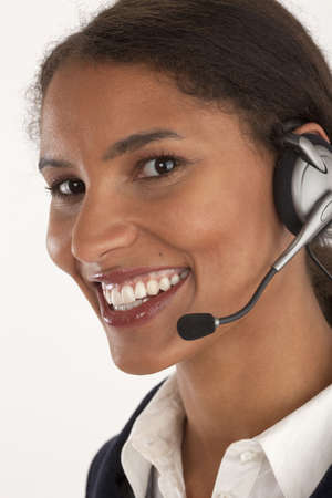 Closeup of young businesswoman wearing headset. Vertically framed shot. photo