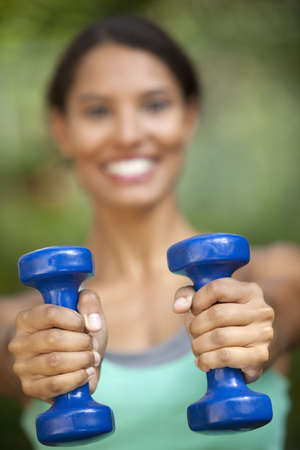 Young woman exercising in outdoor setting. Vertically framed shot. Stock Photo - 6043474