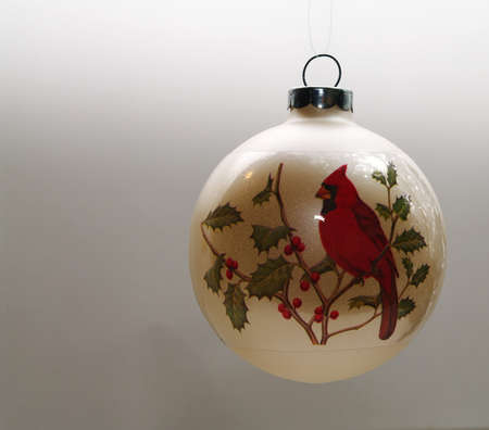 Chritmas ball with a picture of a cardinal