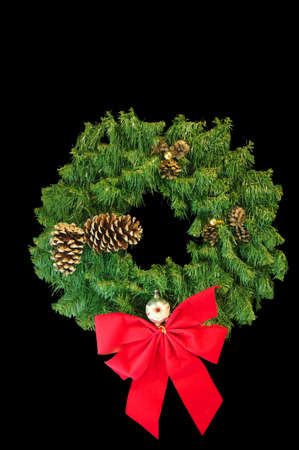 A Green Christmas wreath with a red bow