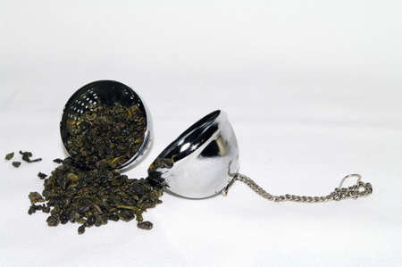 infuser: Green Tea in a tea infuser ball Stock Photo