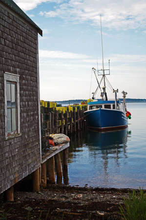 A lobster boat at dock with traps ready for the next sason photo