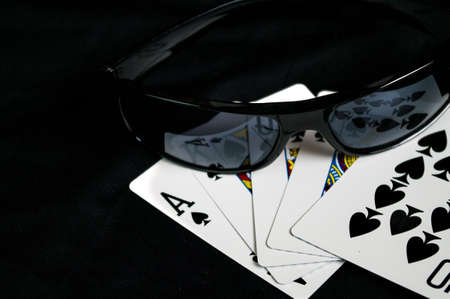 straight flush: Playing Cards and glasses  with a Royal straight flush Stock Photo