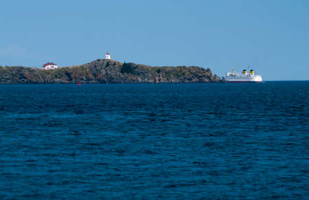Ferry departing around Lighthouse  photo