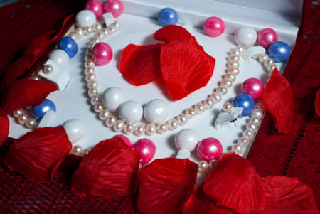 gumballs: Pearls in a presentation case with petals and pearl gumballs