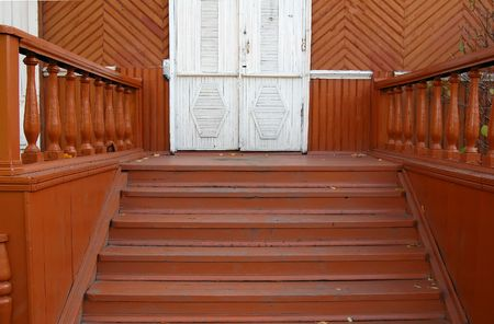 banisters: porch with carved banisters old house Stock Photo