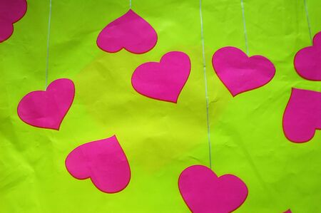 hearts on crushed green background