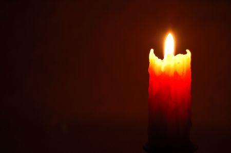 burninging candle on dark background photo