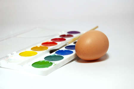 easter paint and egg, macro. Brush on backgrounds photo