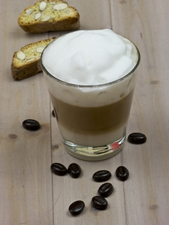 Latte macchiato with coffee beans and biscotti Stock Photo - 17080110