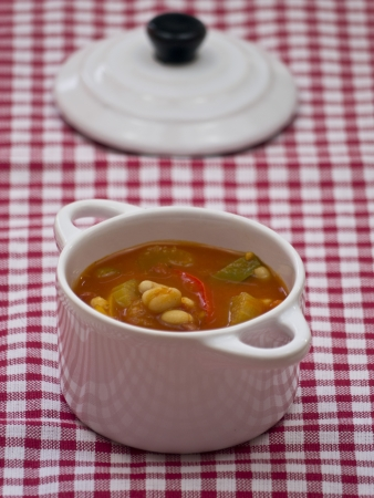 Tomato soup with haricot beans and paprika photo