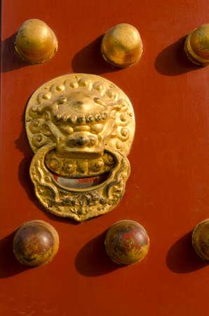 Golden Lion Gate of The Temple of Heaven Tiantan Daoist temple eligious buildings Beijing China