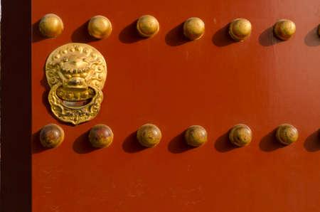Golden Lion Metal Gate of The Temple of Heaven Tiantan Daoist temple eligious buildings Beijing China
