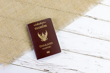 Thai passport on white wood and spinach background