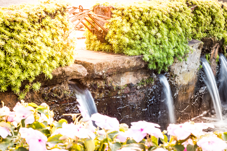 Waterfall in small size in the garden, background photos, nature photos