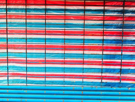 read white and blue canvas and grill of shop front in Hong Kong photo