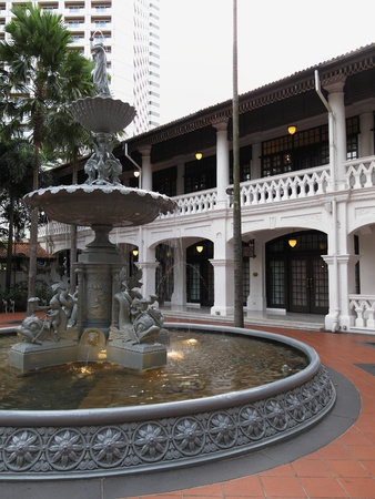 fountain courtyard of Raffles Hotel in Singapore, February 27, 2011 - beautiful fountain against the colonial structure of the hotel