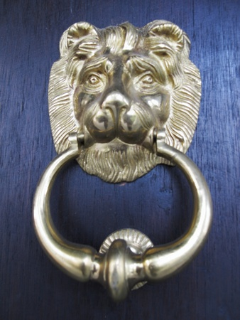 golden lionhead doorknocker of traditional oriental design photo