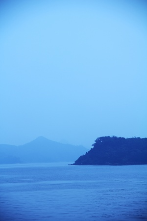 vignetting: blue sky, sea, hill and mist with vintage vignetting effect