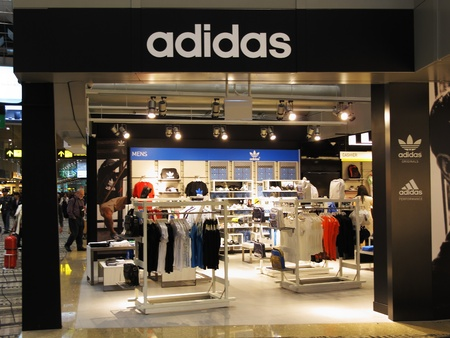 Singapore Changi Airport Terminal 3, March 3, 2011 - Adidas sports retail boutique outlet Stock Photo - 9243796