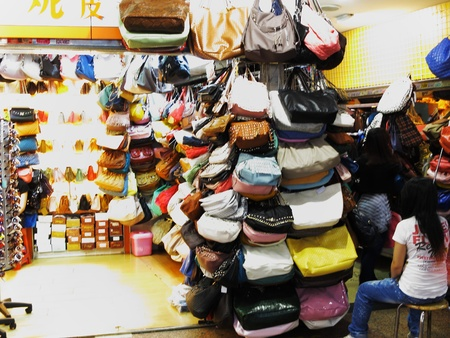 shopping mall in Dongmen area, Luohu District, Shenzhen City, China, May 5, 2011 - shop selling leather bags Stock Photo - 9500643