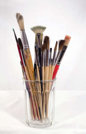 Arrangement of several bristle oil and camel hair watercolor brushes.   photo