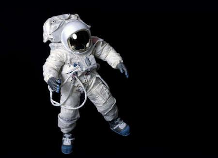 宇宙飛行士の背景でアメリカ圧力スーツを着ています。 写真素材
