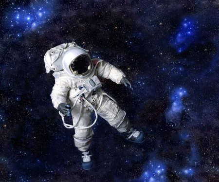 American Astronaut wearing pressure suit against a space background, USA.   Stock Photo