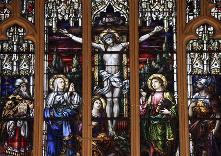 NEW YORK, NY - May 15: Stained glass depicting the Crucifixion of Jesus.  Located inside Saint Thomas Aquinas Church.  Taken May 15, 2009 in the County of the Bronx, New York, USA.
