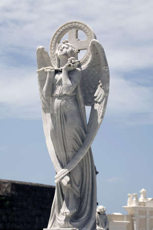 statue of angel in praise of God at cemetery. Stock Photo