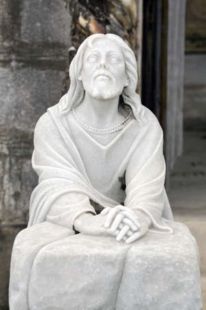 Cemetery statue depicting Jesus as he suffered in the garden of Gethsemane at the foot of the mount of olives. Stock Photo - 9304215
