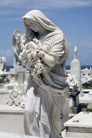statue of woman in mourning at a cemetery in Old San Juan Puerto Rico. photo