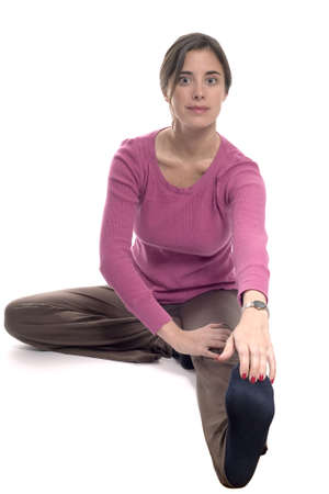 Caucasian woman stretching. Photographed in studio. Stock Photo