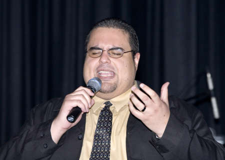 Bronx, NY - April 9: Pentecostal Christian singer Hector Bonano sings during event held at Lehman High School. Taken April 9th, 2011 in the County of the Bronx, NY. Stock Photo - 10290479