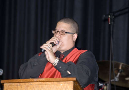 Bronx, NY - April 9: Pentecostal Christian singer Hector Delgado sings during event held at Lehman High School. Taken April 9th, 2011 in the County of the Bronx, NY. Stock Photo - 10290311