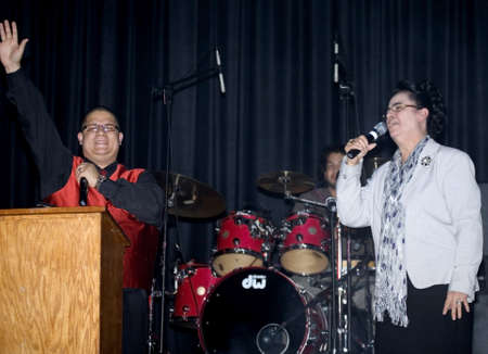 Bronx, NY - April 9: Pentecostal Christian singers Hector Delgado and Carmen Sanabria sing during Christian concert held at Lehman High School. Taken April 9th, 2011 in the County of the Bronx, NY. Stock Photo - 10290507