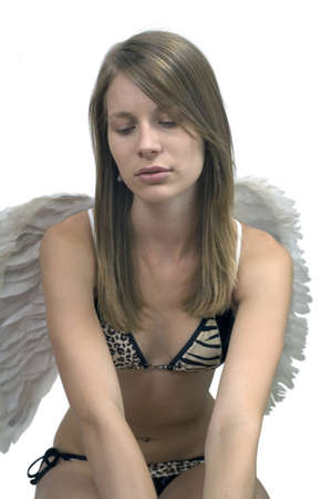 Young girl in bathing suit and angel wings.
