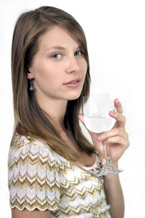 irish ethnicity: Studio image of girl holding wine glass.  She was 19 at the time of shoot and is of Irish ethnicity.   Stock Photo