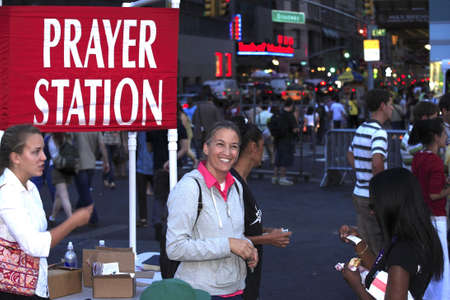 testify: New York, NY - August 23: Wife of Rev. Shawn Holes shown here assists during open air preaching event in Union Square.  Taken August 23rd, 2008 in New York City.