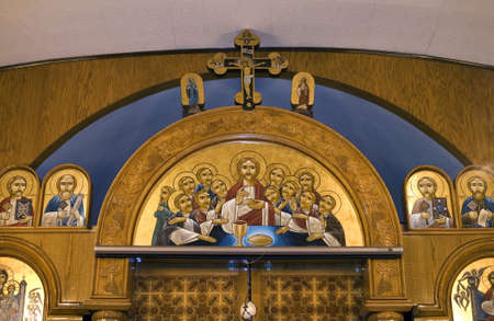 Top section of chapel showing religious icons of Jesus and the twelve apostles and saints.  Photographed inside the Coptic Orthodox Church of St George in Brooklyn NY.  Image taken September 2009 in the USA.